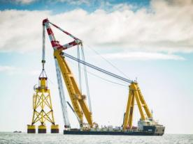 The 25,000 tonne Asian Hercules III installs the first suction bucket jacket foundation for the EOWDC, off Aberdeen Bay. (Photo: Vattenfall)