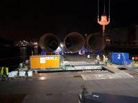 The last three monopiles are loaded onto the barge in Rostock (pict.: EEW SPC/Van Oord)