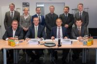 The contract signing of EEW SPC and DONG Energy representatives took place in a low-key ceremony in Rostock. (Photo: EEW SPC)
